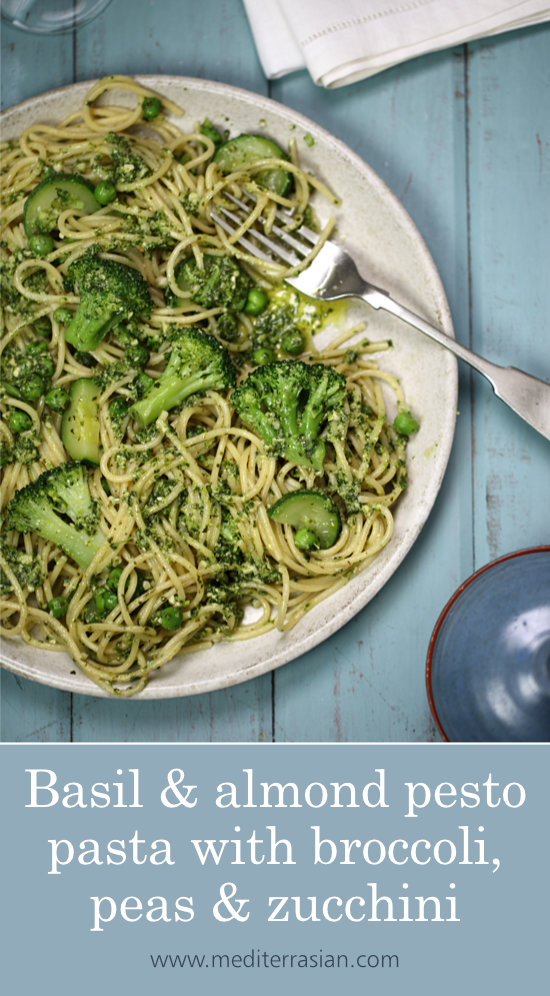 Basil and almond pesto pasta with broccoli, peas and zucchini