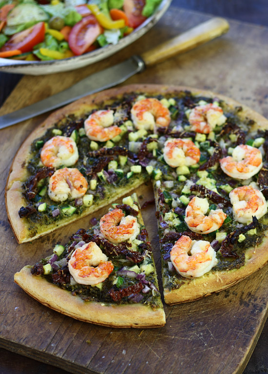Pesto pizza with shrimp, zucchini and sun-dried tomatoes