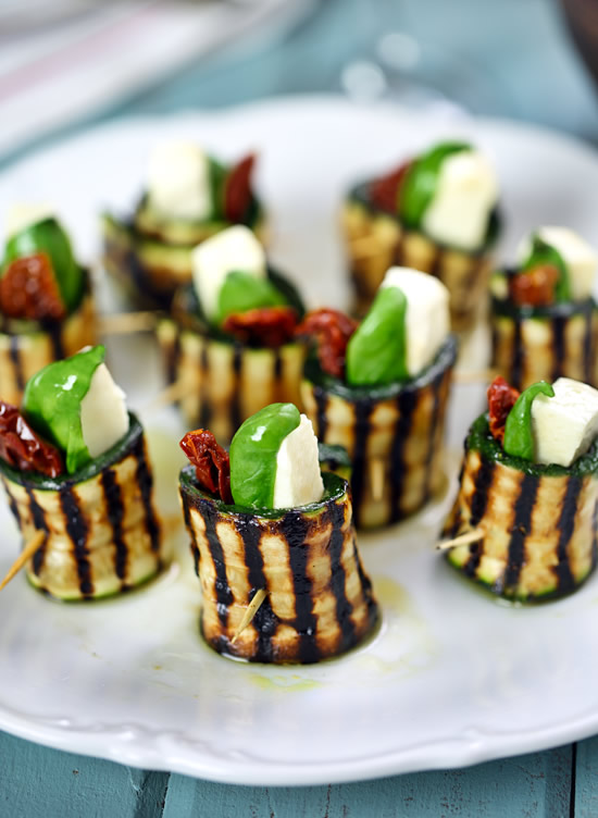 Grilled zucchini roll-ups with mozzarella, basil and sun-dried tomatoes